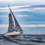 Joakim Brantingson sailing Mini transat with Seaboost Overdrive in fluorescent Race Red